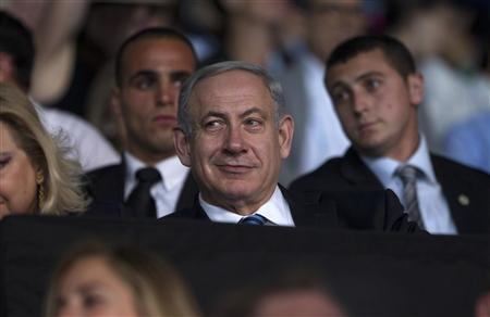 Israel's Prime Minister Benjamin Netanyahu smiles during the opening ceremony of the 19th Maccabiah Games at Teddy Stadium in Jerusalem July 18, 2013. REUTERS/Baz Ratner