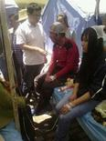 Раненые получают медицинскую помощь в клинике в городе Динси в провинции Ганьсу 22 июля 2013 года. REUTERS/Stringer