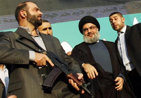 Lebanon's Hezbollah leader Sayyed Hassan Nasrallah (2nd R), escorted by his bodyguards, greets his supporters at an anti-U.S. protest in Beirut's southern suburbs, in this September 17, 2012 file photo. REUTERS/Sharif Karim/Files