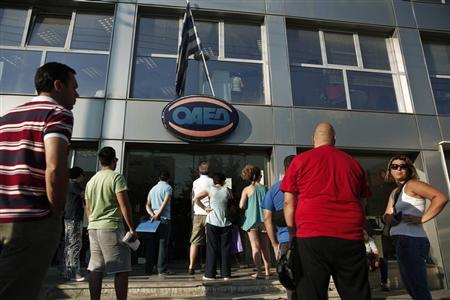 People enter a Greek Manpower Employment Organisation (OAED) office in a northern suburb of Athens July 11, 2013. REUTERS/Yorgos Karahalis