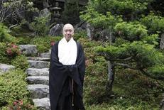 Japanese Buddhist monk Ryusho Soeda poses for a photograph during an interview with Reuters at his temple in Koyasan in Koya, Wakayama prefecture, June 25, 2013. REUTERS/Hideyuki Sano