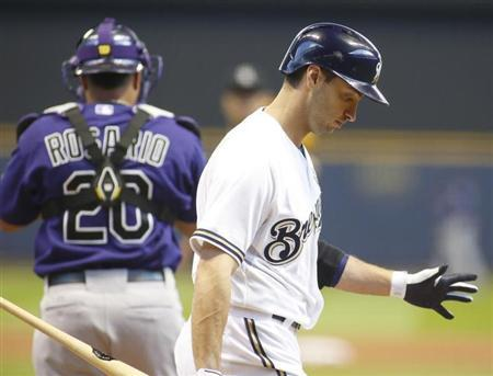 Milwaukee Brewers left fielder Ryan Braun (R) strikes out against the Colorado Rockies during the first inning in an MLB National League baseball game in Milwaukee, Wisconsin April 1, 2013. REUTERS/Darren Hauck