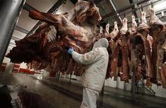 A slaughterer handles beef carcasses at the Biernacki Meat Plant slaughterhouse in Golina near Jarocin, western Poland July 17, 2013. REUTERS/Kacper Pempel