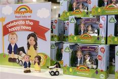Models of Britain's Prince William and his wife Catherine, Duchess of Cambridge, and their newborn baby, are seen on sale in a Mothercare store, in central London July 23, 2013. REUTERS/Paul Hackett