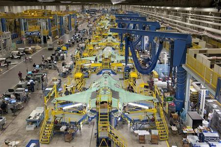 Workers can be seen on the moving line and forward fuselage assembly areas for the F-35 Joint Strike Fighter at Lockheed Martin Corp's factory located in Fort Worth, Texas in this October 13, 2011 handout photo provided by Lockheed Martin. REUTERS/Lockheed Martin/Randy A. Crites/Handout