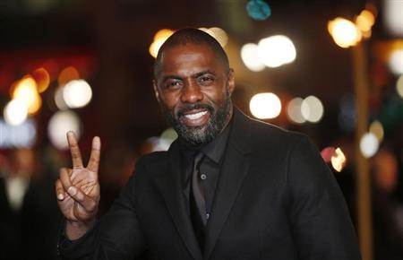 Actor Idris Elba gestures as he arrives for the world premiere of ''Les Miserables'' in London December 5, 2012. REUTERS/Suzanne Plunkett