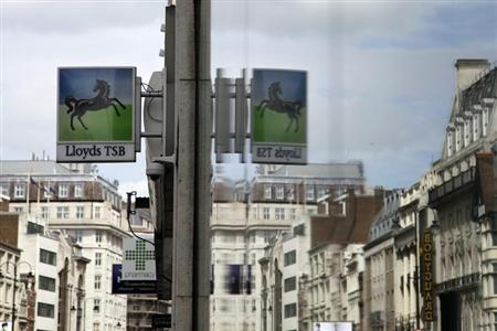 A sign from a branch of a Lloyds bank is reflected in a window in central London May 13, 2013. REUTERS/Stefan Wermuth