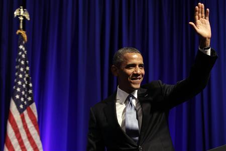 U.S. President Barack Obama waves after delivering remarks at an Organizing for Action dinner in Washington July 22, 2013. REUTERS/Yuri Gripas