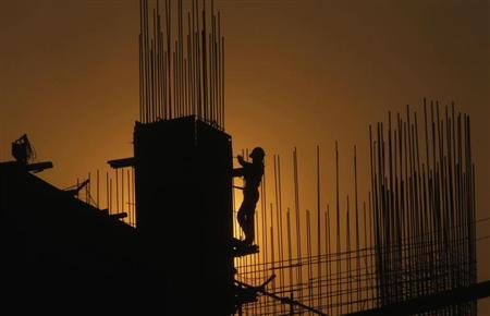 A worker arranges steel structures at a construction site of an apartment in Hanoi June 14, 2013. REUTERS/Kham