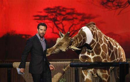 Actor Jason Sudeikis speaks next to a baby giraffe at the seventh annual Spike TV's ''Guys Choice'' awards in Culver City, California June 8, 2013. REUTERS/Mario Anzuoni