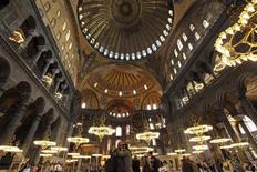 A Macedonian couple (C) takes souvenir pictures as they visit the Byzantine monument of Hagia Sophia or Ayasofya, now a museum, in Istanbul May 25, 2011. REUTERS/Murad Sezer