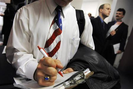 A man wearing a U.S. flag necktie stands in line to talk to prospective employers at the National Capital Region Job Fair sponsored by Virginia Tech University at their branch campus in Falls Church, Virginia, March 10, 2009. REUTERS/Jonathan Ernst