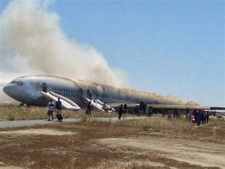 Passengers walk away from Asiana Airlines Boeing 777 aircraft after a crash landing at San Francisco International Airport in California July 6, 2013 in this handout photo provided by passenger Eugene Anthony Rah, released to Reuters on July 8, 2013. REUTERS/Eugene Anthony Rah/Handout via Reuters