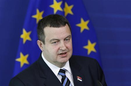 Serbian Prime Minister Ivica Dacic addresses a news conference after meeting European Commision President Jose Manuel Barroso (unseen) at the EU Commission headquarters in Brussels June 26, 2013. REUTERS/Francois Lenoir