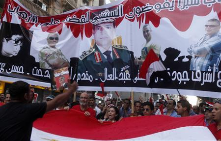 Protesters gather for a mass protest to support the army in Tahrir square in Cairo July 26, 2013. REUTERS-Asmaa Waguih