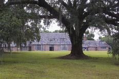"""The manor house that is part of the former Richmond Plantation, a historic property of 152 acres near rural Cordesville, South Carolina is shown in this handout photo taken July 12, 2013, during a """"farewell"""" visit by former Girl Scouts. REUTERS/Cathy Miller/Handout via Reuters"""
