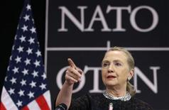 U.S. Secretary of State Hillary Clinton gestures as she addresses a news conference during a NATO foreign ministers meeting at the Alliance headquarters in Brussels December 5, 2012. REUTERS/Francois Lenoir