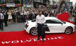 """Actor Hugh Jackman poses at the UK Premiere of """"The Wolverine"""" at Leicester Square in London July 16, 2013. REUTERS/Luke MacGregor"""