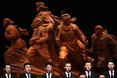 North Korean singers perform during an artistic performance to commemorate the 60th anniversary of the signing of a truce in the 1950-1953 Korean War, at Kim Il-sung Stadium, in Pyongyang July 28, 2013. REUTERS/Jason Lee