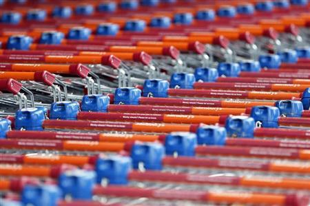 Shopping trolleys are seen parked at a Sainsbury's store in London May 8, 2013. REUTERS/Stefan Wermuth
