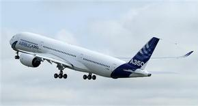 The new Airbus A350 takes off for its maiden flight at the Toulouse-Blagnac airport in southwestern France June 14, 2013. REUTERS/Jean-Philippe Arles