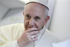 Pope Francis listens to journalists' questions as he flies back Rome following his visit to Brazil July 29, 2013. REUTERS/Luca Zennaro/Pool
