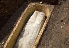 A stone coffin is pictured after its lid was removed at the Greyfriars dig site in this handout photo by the University of Leicester released July 29, 2013. REUTERS/University of Leicester/Handout via Reuters