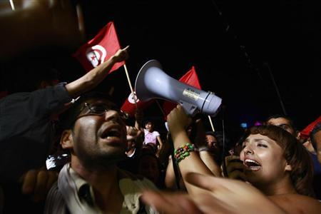 People gather during a protest to demand the ouster of the Islamist-dominated government, outside the Constituent Assembly headquarters in Tunis July 29, 2013. REUTERS/Anis Mili