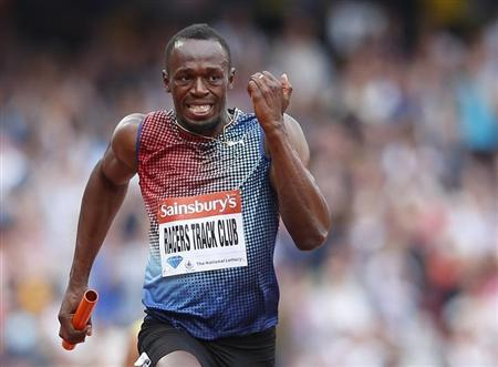 Usain Bolt of Jamaica approaches the finish line after running the final leg for the Racers Track Club to win in the men's 4x100m relay at the London Diamond League 'Anniversary Games' athletics meeting at the Olympic Stadium, in east London July 27, 2013. REUTERS/Andrew Winning