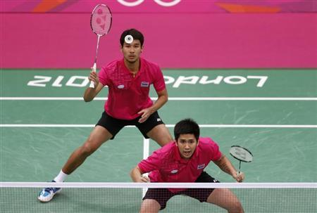 Thailand's Bodin Isara and Maneepong Jongjit play against Poland's Adam Cwalina and Michal Logosz during their men's doubles group play stage Group B badminton match during the London 2012 Olympic Games at the Wembley Arena in this July 30, 2012 file photo. REUTERS/Bazuki Muhammad/Files