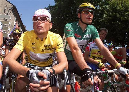Leader's Yellow jersey holder Jan Ullrich of Germany (L) and green sprinter jersey holder team mate and compatriot Erik Zabel wait for the start of the 190,5km 8th stage of the Tour de France Cycling race from Brive-La-Gaillarde to Montauban in this July 19, 1998 file picture. REUTERS/Paul Hanna/Files
