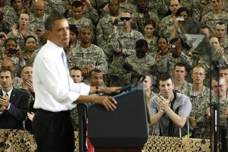 A soldier wounded in Afghanistan applauds as U.S. President Barack Obama speaks to troops at Fort Campbell in Kentucky May 6, 2011. REUTERS/Kevin Lamarque
