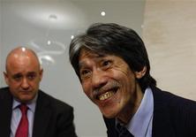 Macau lawmaker David Chow Kam-fai (R), also Co-Chairman, Executive Director and Chief Executive Officer of Macau Legend Development, smiles beside Executive Director Sheldon Trainor in Hong Kong July 5, 2013. REUTERS/Bobby Yip