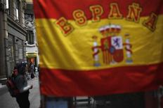 A man asks for alms at a shopping district in central Madrid June 19, 2013. REUTERS/Susana Vera