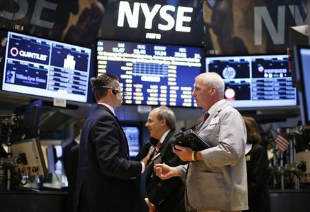 Traders work on the main trading floor of the New York Stock Exchange (NYSE) shortly after the opening bell in New York, in this file photo from May 20, 2013. REUTERS/Mike Segar/Files