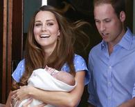 Britain's Prince William and his wife Catherine, Duchess of Cambridge appear with their baby son outside the Lindo Wing of St Mary's Hospital, in central London July 23, 2013. REUTERS/Cathal McNaughton