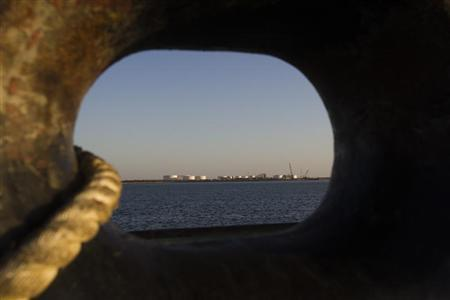 EDITORS' NOTE: Reuters and other foreign media are subject to Iranian restrictions on leaving the office to report, film or take pictures in Tehran. A general view of an oil dock is seen from a ship at the port of Kalantari in the city of Chabahar, 300km (186 miles) east of the Strait of Hormuz January 17, 2012. REUTERS/Raheb Homavandi