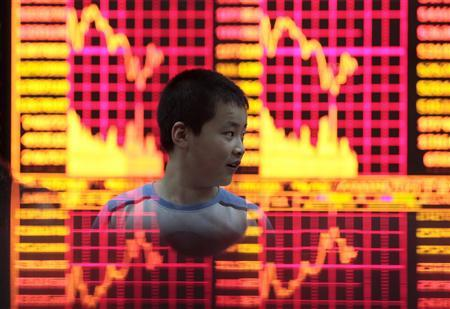 A boy plays at a brokerage house in Shanghai in this July 30, 2009 file photo. REUTERS/Aly Song/Files