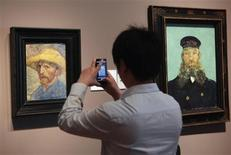 A visitor uses his cell phone to take a picture of the 'Self Portrait' painting by painter Vincent van Gogh at the Detroit Institute of Arts museum in Detroit, Michigan in this file photo taken July 21, 2013. REUTERS/ Rebecca Cook/Files