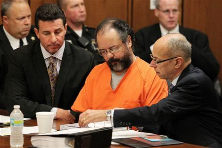 Ariel Castro (C), 53, sits as his attorneys Craig Weintraub (L) and Jaye Schlachet (R) review documents during Castro's sentencing on Kidnapping, rape and murder in Cleveland, Ohio August 1, 2013. REUTERS/Aaron Josefczyk