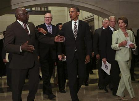 U.S. President Barack Obama (C) confers with House Minority Leader Rep. Nancy Pelosi (D-CA) (R) and Rep. James Clyburn (D-SC) (L) after a meeting with House Democrats at the Capitol Visitor's Center in Washington July 31, 2013. REUTERS/Gary Cameron
