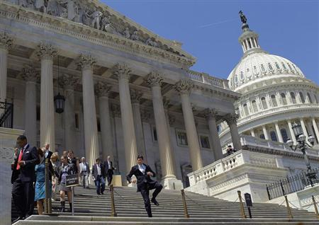 Members of the House of Representatives and their staffs leave the U.S. Capitol, adjourning after their final vote of the day in Washington April 26, 2013. REUTERS/Gary Cameron