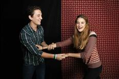 """Actors Miles Teller (L) and Shailene Woodley pose for a portrait together while promoting the film """"The Spectacular Now"""" in Beverly Hills, California July 29, 2013. REUTERS/Danny Moloshok"""