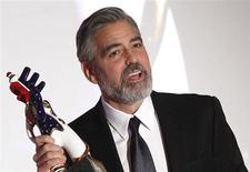 U.S. actor George Clooney reacts with the German Media Award 2012 after he was honoured during a ceremony in Baden Baden February 26, 2013. REUTERS/Lisi Niesner