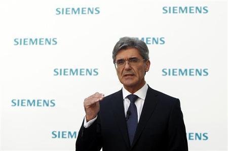 Newly elected Siemens CEO Joe Kaeser gestures during a news conference in Germany's Siemens AG headquarter in Munich July 31, 2013. REUTERS/Michaela Rehle
