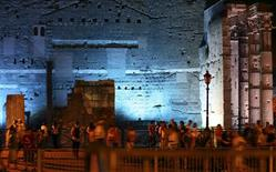 People walk as they visit the Fori Imperiali street during a ceremony to inaugurate a scheme that bans private vehicles on it, in Rome August 4, 2013. REUTERS/Alessandro Bianchi