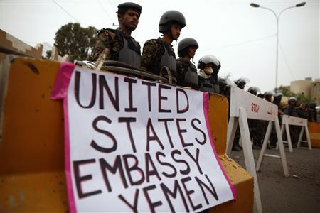 Riot policemen stand guard during a protest to demand the release of Yemeni detainees in the prison of Guantanamo Bay, outside the U.S. embassy in Sanaa in this June 17, 2013, file photo. REUTERS/Khaled Abdullah/Files