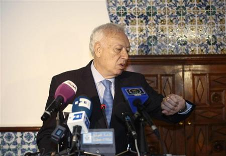 Spanish Foreign Minister Jose Manuel Garcia-Margallo (L) attends a news conference with Algeria's Foreign Minister Mourad Medelci in Algiers June 18, 2013. REUTERS/Ramzi Boudina