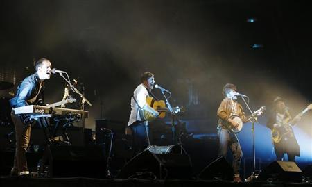 Mumford & Sons, (from L) Ben Lovett , Marcus Mumford, Winston Marshall and Ted Dwane perform on the Pyramid Stage at the Glastonbury music festival at Worthy Farm in Somerset, June 30, 2013. REUTERS/Olivia Harris