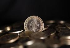 Stacks of Turkey's lira coins are seen in this picture illustration taken in Istanbul July 15, 2013. REUTERS/Osman Orsal